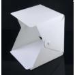 Mechanikus analóg kézi számláló, counterÖsszehajtható fekete-fehér hátterű fotódoboz, stúdiódoboz LED megvilágítással